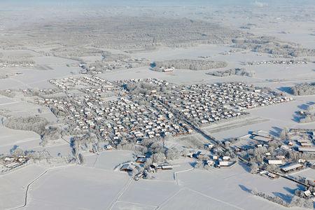 Luftaufnahme Ort Lutten im Schnee